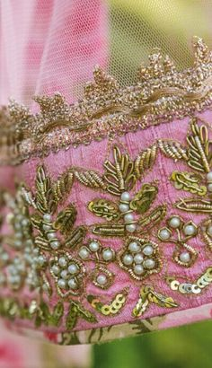 Intricate handwork with pearl motifs