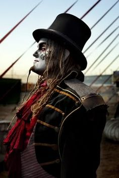 Cirque Berzerk clown. We don't want to go too crust punk, horror film, Jim Rose Circus, or too steampunk (even though we started out steampunk) but I like the makeup and costuming. - J