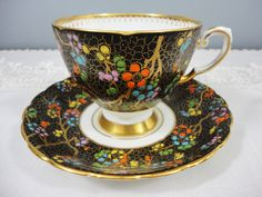 Rare Tuscan Matte Black Bone China Teacup and Saucer - Hand Painted Enameled Dots - Gold Branches by AllDressedUpHome on Etsy https://www.etsy.com/listing/473774810/rare-tuscan-matte-black-bone-china