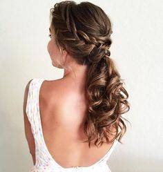 Love is in the air ! This beauty is sporting the most romantic 'do that is perfect for all our stunning brides to be . She adds braids and curls to the classic low ponytail for an elegant wedding 'do !  : @hair_by_zolotaya  #NuMeStyle #hairoftheday #weddinghair
