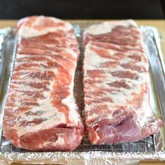 Who says you need a grill to cook good ribs? The lack of outdoor space for a grill at my apartment led me to pass up a good many recipes for barbecued ribs over the years. Now I'll be making up for lost time. I do believe I've cracked the code to making perfectly tender and mouth-watering barbecued ribs in the oven.
