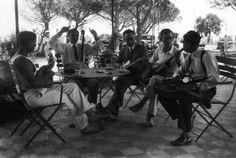 Émile Savitry's self portrait (with glasses) with Django Reinhardt (hands up) and Joseph Reinhardt (first right), Toulon 1930