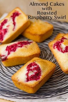 Almond Cakes with Roasted Raspberry Swirl are moist and delicious little individual mini cakes baked up with a delicious sweet tart raspberry swirl. A very impressive and fun dessert that everyone will love. Köstliche Desserts, Best Dessert Recipes, Cupcake Recipes, Delicious Desserts, Icing Recipes, Loaf Recipes, Cookbook Recipes, Sweets Recipes, Kitchen Recipes