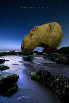 Penedo do Guincho, Santa Cruz, Portugal. Stunningly similar to Natural Bridges State Park in Santa Cruz, California.