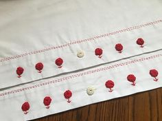 Red Work Pillowcase set. Hand embroidered Yoyo flowers and
