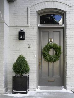 Painted brick with grey door ..