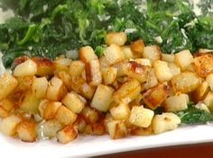 Hash Brown Potatoes - this sort of reminds me of my German Grandma's potatoes. Of course, she didn't have Emeril's seasoning and she made all her cuts irregular.