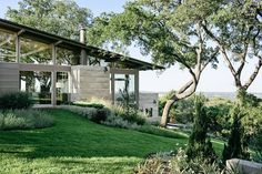 Overlooking downton Austin, the Hillside House uses its sloped terrain to amplify views of the neighboring cityscape. The home is broken up into two levels, joined by a standing-seam metal roof. Sitting on top of the bluff, the main floor...