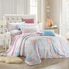 Brighten any little girl's room with the Laila 3 Piece Reversible Duvet Set. The set features paisley prints and vivid colors on a white background. Both the duvet and shams are machine washable. Bed Sets, Silk Bedding, Bedding Sets, Luxury Bedding Collections, Quilt Sets, Bed Design, Duvet Cover Sets, Pink, Home Decor