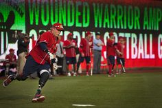 Roundin' First: Wounded Warrior Marine veteran Josh Wege rounds first base after hitting the ball past the outfielders during the Wounded Warrior Amputee Celebrity Softball Classic at the Nationals' ballpark in  Washington April 3. Wege, from Campbellsport, Wis., is part of the  Washington Nationals Wounded Warrior Amputee Softball Team made up of veterans and active duty service members from across the U.S., who lost limbs while serving in Iraq or Afghanistan. The wounded warriors won 17-4.