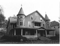 Holmes built only one house in Wilmette, at what was then 38 N. John Street between Lake and Central. A Queen Anne duplex with turrets flanking a central porch, the Holmes house was originally painted dark red.