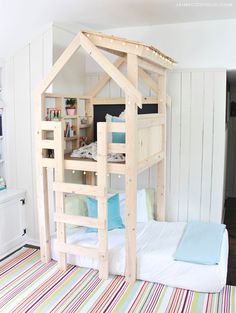 A DIY tutorial to build an indoor playhouse kids loft over a twin bed. Make your kids dreams come true with free plans from Ana White for this awesome loft. Diy Bett, Diy Home Decor Rustic, Build A Playhouse, Garden Playhouse, Kids Indoor Playhouse, Outdoor Playhouses, Playhouse Kits, Loft, Kid Beds