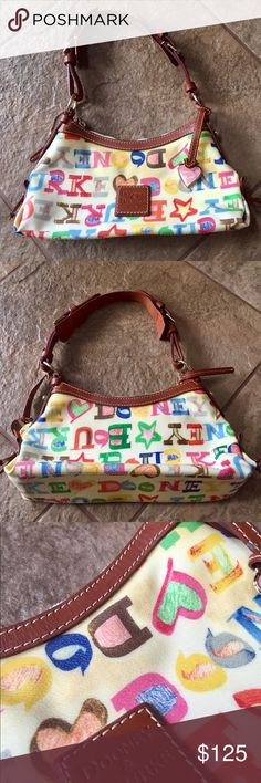 NWOT! DOONEY & BOURKE Mini East West Slouch 🔷BUNDLE & SAVE 30%🔷 Leather detail, fully lined,  cream color with multi-colored outside pattern, rainbow zip top closure, pink heart hangtag, shoulder strap is adjustable. Only flaw is discoloration at the top of the bag as pictured. Never used! 11.25in(L) 6in(H) 3.25in(W) Dooney & Bourke Bags Shoulder Bags