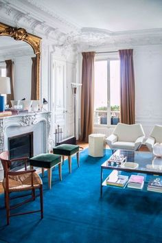 Saturated color & mod furniture jazz up this French interior