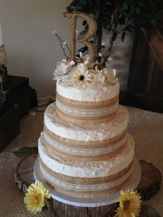 Round Wedding Cakes - Rustic theme wedding cake. Borders are burlap with lace, and flowers are fake.