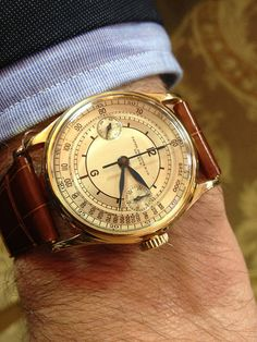 gold face watch, brown leather strap