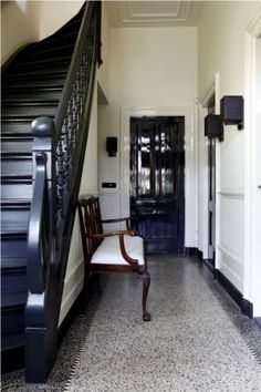 Granite old floor with border, black staircase. - black staircase with black trim on bottom. Chair rail and crown molding left white. I like this for the foyer in restaurant