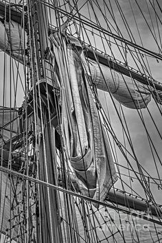 Black and white detail view of the main mast and sails of the Ecuadorian Buque Escuela Guayas sail ship while docked in New York city during it's visit for Fleet Week in 2012.