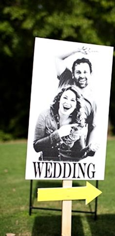 love the use of engagement photo for their wedding sign :)
