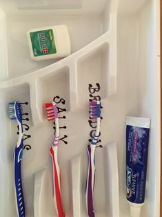A Dollar Store utensil tray serves as an organizer for kids toothbrushes and toothpaste.
