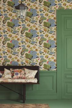 Nympheus wallpaper design featuring kingfishers flying above an egret who shelters beneath drooping lotus leaves.
