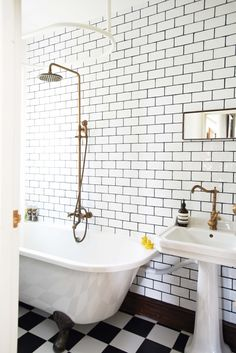 KBBArk - Rustic House with an Art Deco influences. wall tiles tiling mirror brass tap tap sink wash basin door knob metro tiles black grouting dark grouting contemporary chequered flooring monochrome