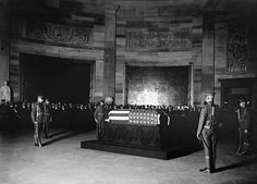 The Unknown Soldier lay in state in the Capitol Rotunda from his arrival in the United States until Armistice Day, 1921. On Nov. 11, 1921, President Warren G. Harding officiated at the interment ceremonies at the Memorial Amphitheater at Arlington National Cemetery.