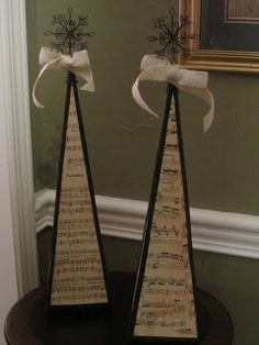Music sheet pyramids, great decorating idea!!  A Mcinnis Artworks: That's Music to my Ears!
