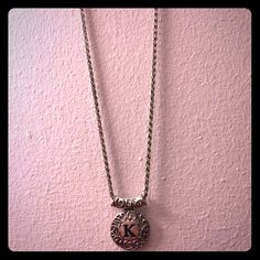"""Silver costume necklace Silver costume necklace with a """"K"""". Never worn. Jewelry Necklaces"""
