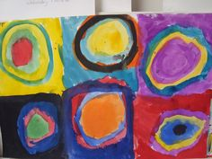 Kandinsky inspired concentric circles! The students drew with their paint brush and alternated warm and cool.  Kindergarten art lesson project idea