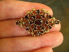 14k gold garnet pendant/brooch on Etsy $395 with free shipping