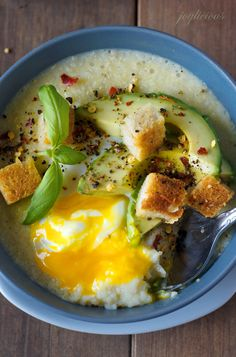 Delicious cheesy grits and soft Poached egg with an avocado on top looks like a winner.