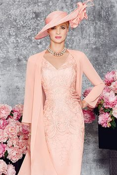 Short tailored dress with v neck and slight capped sleeve. There is a graduated heavy lace overlay on the body of the dress. The chiffon coat is the same leng