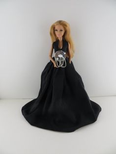 A Sleek Black Gown with Silver Accents At the Waist Made to Fit the Barbie Doll Olivia's Doll Closet,http://www.amazon.com/dp/B00FQMPRZK/ref=cm_sw_r_pi_dp_KFQHsb1AVRA0NGCP