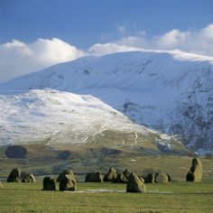 Derwentwater, Lake District, Cumbria, UK Castlerigg Stone Circle, with Clough Head beyond, snow covered. Free standing megalithic stone circle of 38 stones