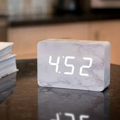 Ging-ko's beautiful portable alarm clock has a wood body with a marble finish. Its white LED digits appear when you snap your fingers, clap your hands, tap My New Room, My Room, Minimal Decor, House Rooms, Dream Bedroom, Apartment Living, School Supplies, Room Inspiration, Bedroom Decor