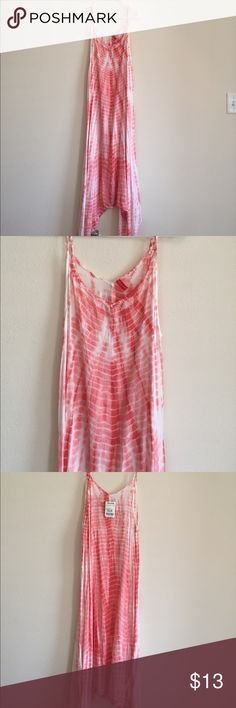 Patterned Midi Summer Dress Patterned Midi Summer Dress purchased from TJ Maxx. NWT! Dress is Midi in the front and back and longer on the sides. Has adjustable straps and is Super cute with wedges! Dresses Midi