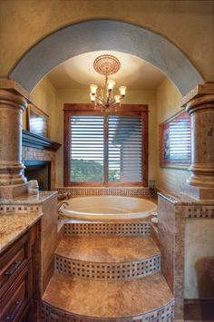 Love love love this bathtub! Chandelier, and a fire place..... I'm in love