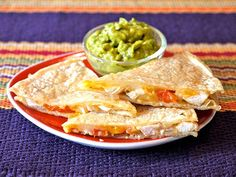 Yummy! 10 Delicious Back-to-School Lunch Ideas Kids Will Love | CHICKEN FAJITA QUESADILLA | Don't toss those leftovers – turn them into a fun lunch the next day. Whenever you've got roasted or grilled veggies or chicken, just add cheese and you've got a delectable quesadilla in minutes (cut it into wedges for little hands, and kids will go crazy for it). Get the recipe.
