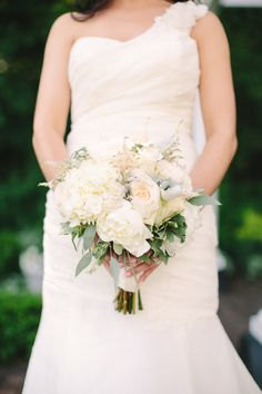 Classic white peony #bouquet with accents of dusty miller and eucalyptus leaves.   Photography: Weber Photography- Cory Weber - weber-photography.com  Read More: http://www.stylemepretty.com/2014/06/27/northern-michigan-destination-wedding/