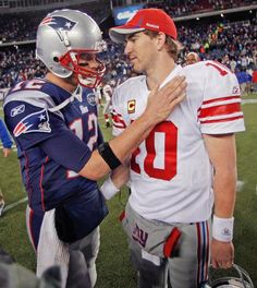 New York Giants' Eli Manning, right, is congratulated by New England Patriots' Tom Brady