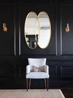 Black walls and white chair with gold mirrors for the hallway. Follow In A Circle for more: www.inacircle.co