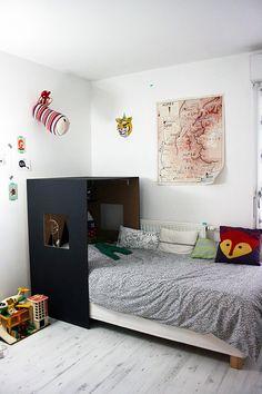 Simple custom headboard hideaway nook in a kid's room