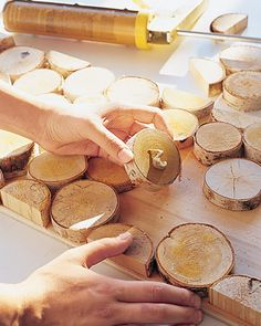Birch poles sliced into disks and glued to plywood panels create a graphic wall mosaic. Strategically placed longer pieces can be used as hooks for bags and artwork.Purchase crosscut birch rounds at a garden center, or have poles cut into disks at a lumberyard. Ours range in depth from 3/4 to 1 1/2 inches to give the wall some texture. To create hooks for hanging coats or bags, you will also need a few longer pieces (4 to 8 inches). The disks are applied to plywood panels; create several...