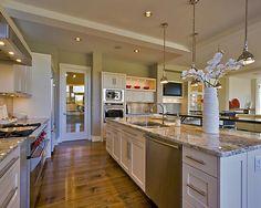 White cabinets w granite countertops and hardwood floor