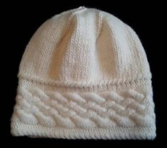 "This hat was designed for my daughter-in-law as a special request. She wanted a warm hat with a simple cable design to wear during the cold Philadelphia winters.The cable band is worked flat to desired head circumference then seamed. Instructions create a 22"" circumference but instructions are given to customize this number. Stitches are then picked up along the edge and crown is completed in the round using stockinette stitch. Stitch pattern is charted and written to allow for individual…"