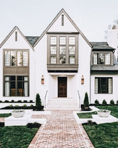 I love this exterior. The white brick, and the windows. How would it work with our window boxes?? #ClassicExteriorDesign