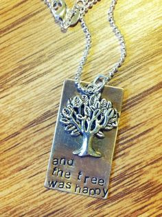 "hand stamped ""and the tree was happy"" (from The Giving Tree) quote antique brass necklace with silver tree charm, customized with names. $18.00, via Etsy."