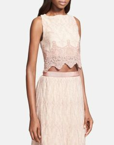 Feeling dainty in an embroidered crop top.