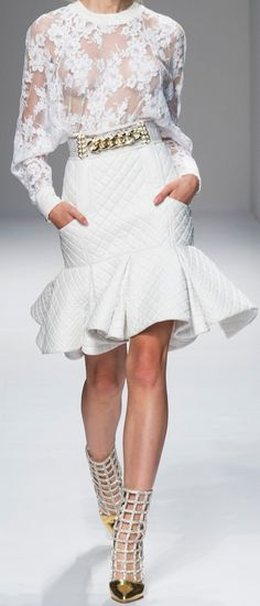 Balmain white lace top, white quilted peplum skirt with gold belt and cage shoes